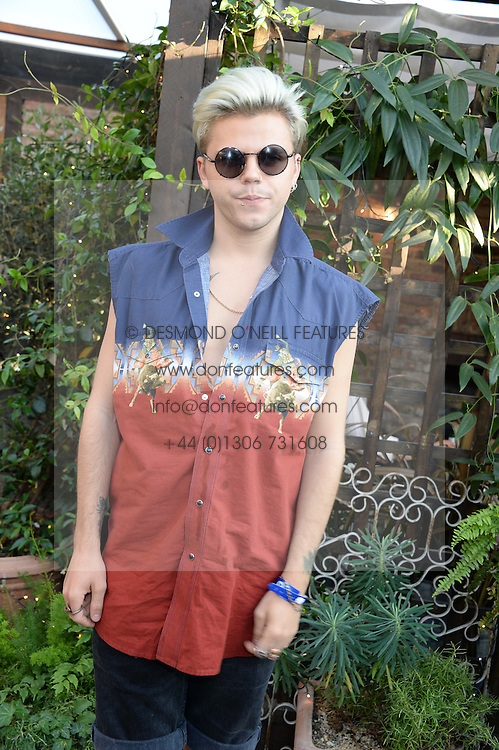 VINCE KIDD attending the Warner Bros. & Esquire Summer Party held at Shoreditch House, Ebor Street, London E1 on 18th July 2013.