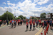 Manchester United fans arrive down Sir Matt Busby Way with the cricket ground in background hosting One  Love Manchester concert before the Michael Carrick Testimonial Match between Manchester United 2008 XI and Michael Carrick All-Star XI at Old Trafford, Manchester, England on 4 June 2017. Photo by Phil Duncan.