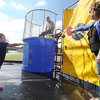 Lauren Wood | Buy at photos.djournal.com<br /> Dr. C.K. White waits in the bunk tank as Mary Beth Vinson helps her granddaughter Finley Baker, 3, with her throw Thursday morning during the Dunk A Boss fundraiser at the Courtyard by Marriott hotel. Vinson works with Dr. White at Sanders Clinic for Women, and the fundraiser benefits Habitat for Humanity.