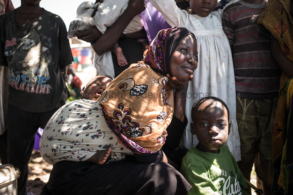 DRC / Burundi Refugees /  A Burundian refugee rests after arriving on the DRC coast  fleeing  insecurity in Burundi. <br /> More than 9000 Burundians refugees have crossed into the DRC over the past few weeks. The new<br /> arrivals are being hosted by local families, but the growing numbers are straining<br /> available support. Work is ongoing to identify a site<br /> where all the refugees can be moved, and from where they can have access to<br /> facilities such as schools, health centers and with proper security. / UNHCR / F.Scoppa / May 2015