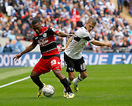 Jamie Ward of Derby County (left) battles with Junior Hoilett of Queens Park Rangers during the Sky Bet Championship Play Off final at Wembley Stadium, London<br /> Picture by Andrew Tobin/Focus Images Ltd +44 7710 761829<br /> 24/05/2014