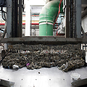 February 19, 2015 - New York, NY : Large screens (not visible) filter large debris from raw sewage underground in the preliminary stage of the wastewater treatment process at the Newtown Creek Wastewater Treatment Plant. Mechanical rakes, one of which is pictured here, then shuttle the debris above ground, where it is collected for disposal. While larger items occasionally make their way into the sewers via storm drains on the street, wet wipes make up the vast majority of the solid waste entering the city's sewage treatment system today. CREDIT: Karsten Moran for The New York Times
