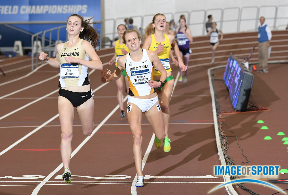Mar 11, 2017; College Station, TX, USA; Dani Jones of Colorado (left) defeats Marissa Schweizer of Missouri to win the women's 3,000m, 9:09.20 to 9:09.33, during the NCAA Indoor Track and Field Championships at the Rhonda and Frosty Gilliam Jr. Indoor Track Stadium at the McFerrin Athletic Center.