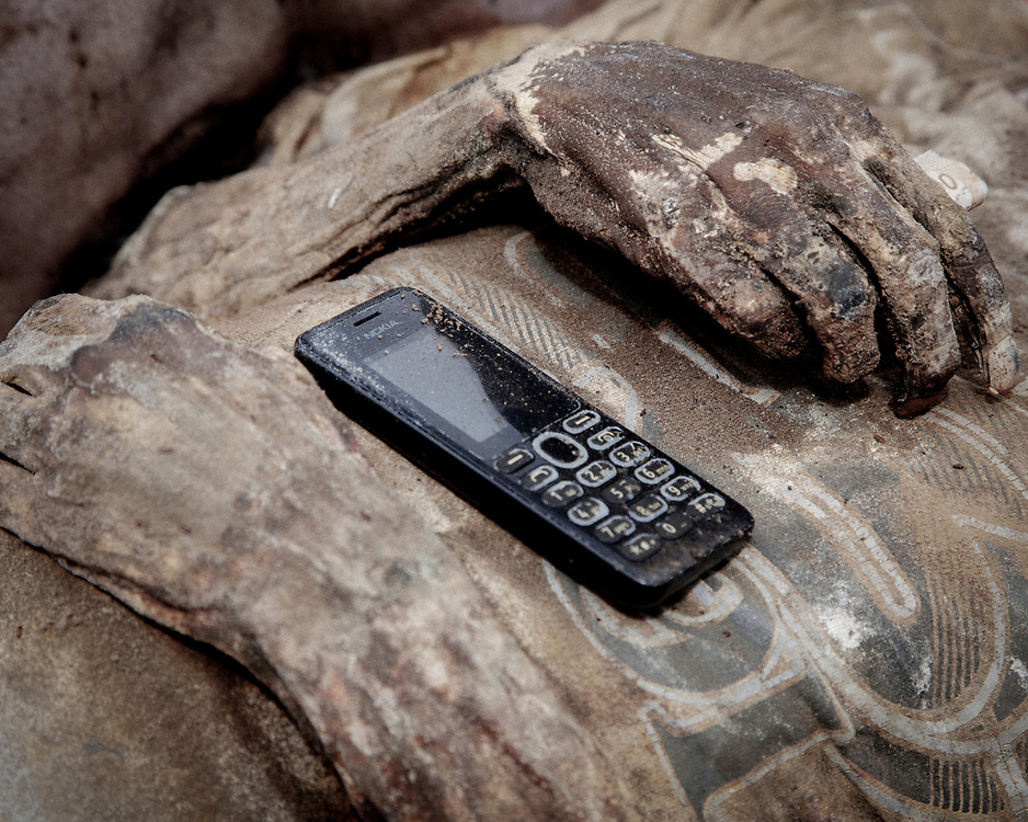 Personal possessions like this cell phone is often included inside the coffin.<br /> <br /> Ma'nene is a tradition that takes place in August after harvest where the bodies of the dead loved ones are exhumed to be cleaned, groomed and dressed. For most, it's a bittersweet moment, a chance to reunite and physically see and touch and reconnect with loved ones who had passed on.