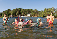 "Cyndal Grant-Vansteensburg, Sydni Lehr, Seanna Langley and Abby Jarvi enjoy ""noodle"" racing at Gilford Beach during the Kick Off to Summer event put on by Gilford Parks and Recreation Wednesday evening.  (Karen Bobotas/for the Laconia Daily Sun)Gilford Parks and Recreation Summer Kick Off Party at Gilford Beach June 29, 2011."