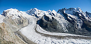 """Monte Rosa massif / Dufourspitze (4634 m / 15,203 ft, second-highest mountain of the Alps and highest of Switzerland), Castor & Pollux, and Breithorn (""""broad horn"""", 4164 m) seen from Rotenboden, in the Pennine/Valais Alps, Europe. In Zermatt, the Gornergrat rack railway (GGB) takes you to a spectacular ridge (at 3135 m or 10,285 ft) between Gornergletscher and Findelgletscher. Gornergrat train, opened in 1898, climbs almost 1500 m or 4900 ft. Gornergrat train, opened in 1898, climbs almost 1500 m or 4900 ft via Riffelalp and Riffelberg. This image was stitched from multiple overlapping photos."""