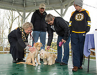 "Pastor Ruth Martz offers a blessing to ""Maggie"" and ""Rosey"" with Steve Majeski, Rhonda Morris and Sam Harbrook during the animal blessing at the Sanbornton Congregational Church on Sunday evening.  (Karen Bobotas/for the Laconia Daily Sun)"