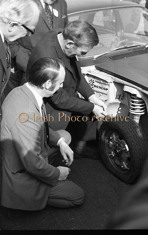 Dunlop Total Mobility Tyre At Mondello Park..1972..13.10.1972.10.13.1972..13th October 1972..A revolutionary new tyre development which can end the hazardous effects of a blowouts and punctures was announced by Dunlop.The T4 Total Mobility Tyre is designed to allow the motorist to continue for a distance of up to 100 miles at speeds of 50mph even if the tyre is deflated. The tyre is designed to enable the driver maintain control of the vehicle in the event of a blowout...Image of Mr P J McGowan,Chief engineer,Dept of Local Government watched by Mr John Sheridan,Director,Irish Dunlop Ltd as he punctures the prototype tyre on the test vehicle.