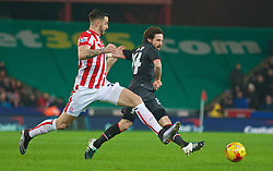 STOKE-ON-TRENT, ENGLAND - Tuesday, January 5, 2016: Liverpool's Joe Allen in action against Stoke City during the Football League Cup Semi-Final 1st Leg match at the Britannia Stadium. (Pic by David Rawcliffe/Propaganda)