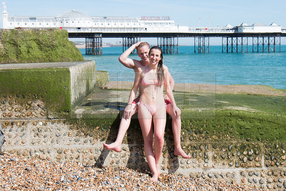 © Licensed to London News Pictures. 06/05/2016. Brighton, UK. 20 year old Iciar from Spain and her boyfriend, 24 Year old Dylan from Brighton go for a swim in the sea and relaxes on the beach as the seaside resort basks in sunshine. Photo credit: Hugo Michiels/LNP