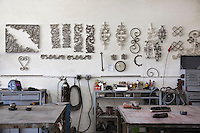 Metal designs on wall in workshop