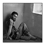Faces of Mosul<br /> <br /> A collection of images from 4 time Pulitzer prize winning photographer Carol Guzy, gives us a glimpse into the faces of those affected by the fierce conflict with ISIS in Mosul. Wounded and weak, most who survived now face an uncertain future in the limbo of IDP camps. Shattered lives, lost loved ones and escape from the rubble of collapsed homes and the evil of ISIS doctrine, leaves scars of emotional trauma even more difficult to heal. The war in Mosul is over, but the humanitarian crisis continues.<br /> <br />  Mosul, Iraq - MOHAMMED ABD HAMAD, 20 and two others surrendered after being surrounded by ISOF Special Forces who believe they are ISIS fighters in West Mosul amid ruins of the city. They say they are not.  They are held captive at a base near the front line.  <br />  &copy;Carol Guzy/zReportage.com/Exclusivepix Media