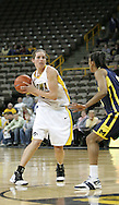 08 February 2007: Iowa forward Wendy Ausdemore (32) drives to the basket in Iowa's 66-49 win over Michigan at Carver-Hawkeye Arena in Iowa City, Iowa on February 8, 2007.