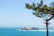 SANTANDER, SPAIN - April 18 2018 -  View over the Bay of Santander and Mouro Island & lighthouse from  Magdalena Peninsula, Cantabria, Northern Spain, Europe.