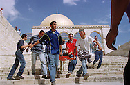 Photo: Nadav Neuhaus.29/9/00 Jerusalem, Israel...As a result of Ariel Sharons (head of the opposition in the Israeli parliament) visit in Temple Mount (El-Actza Mosque) on Wednesday, 28/9/00, commotion errupted during the Friday prayers. Stones and bottles where thrown towards the Wall..Police forces entered the Temple Mount zone, an area which is not usually embarked by security forces. The police responded with gun fire and tear gas, causing the death of four Palestinians and wounding hundreds .Arrests were made and there where also fourty four wounded among the Israeli security forces.