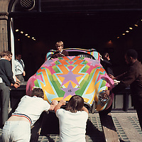 "Honorable Tara Browne, friend of the Beatles in his psychedelic-painted AC Cobra exiting window of Robert Fraser Gallery.  Published in Jon Naar's ""Getting the Picture"", 2005. Taken with a 6x6 cm Hasselblad in 1966."