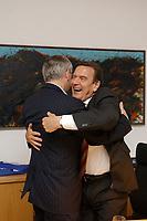 23 SEP 2002, BERLIN/GERMANY, 00:21 h:<br /> Gerhard Schroeder (R), SPD, Bundeskanzler, begruesst Joschka Fischer (L), B90/Gruene, Bundesaussenminister, herzlich in seinem Buero in der Nacht zum 23. September 2002, Wahlabend der Bundestagswahl 2002, Willi-Brandt-Haus <br /> IMAGE: 20020922-01-090<br /> KEYWORDS: Gerhard Schröder, Wahlabend 2002,
