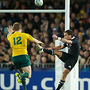 Aaron Cruden, New Zealand, kicks past Pat McCabe, Australia, during the New Zealand V Australia Semi Final match at the IRB Rugby World Cup tournament, Eden Park, Auckland, New Zealand, 16th October 2011. Photo Tim Clayton...