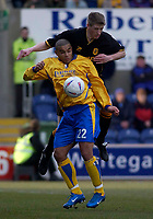 Photo. Glyn Thomas.<br /> Mansfield Town v Hull City.<br /> Nationwide League Division 3.<br /> Field Mill, Mansfield. 06/03/2004.<br /> Hull's Richard Hinds (R) fights an aerial battle for possession with Iyseden Christie.