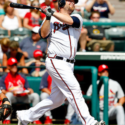 March 19, 2012; Lake Buena Vista, FL, USA; Atlanta Braves catcher Brian McCann (16) hits a solo homerun during the bottom of the seventh inning of a spring training game against the St. Louis Cardinals at Disney Wide World of Sports complex. Mandatory Credit: Derick E. Hingle-US PRESSWIRE