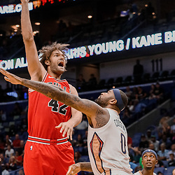 Oct 3, 2017; New Orleans, LA, USA; Chicago Bulls center Robin Lopez (42) shoots over New Orleans Pelicans forward DeMarcus Cousins (0) during the first half of a NBA preseason game at the Smoothie King Center. Mandatory Credit: Derick E. Hingle-USA TODAY Sports