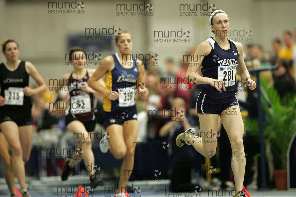 (Windsor, Ontario---12 March 2010) Megan Brown of University of Toronto   competes in the 1000m final at the 2010 Canadian Interuniversity Sport Track and Field Championships at the St. Denis Center. Photograph copyright Sean Burges/Mundo Sport Images. www.mundosportimages.com