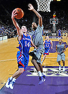 MANHATTAN, KS - FEBRUARY 14:  Guard Tyrel Reed #14 of the Kansas Jayhawks drives to the basket against forward Jordan Henriquez-Roberts #21 of the Kansas State Wildcats during the second half on February 14, 2011 at Bramlage Coliseum in Manhattan, Kansas.  Kansas State defeated Kansas 84-68.  (Photo by Peter G. Aiken/Kansas State/Getty Images) *** Local Caption *** Tyrel Reed;Jordan Henriquez-Roberts