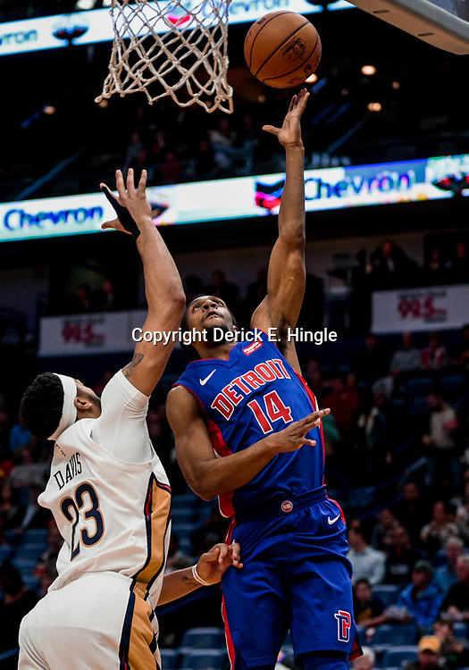 Jan 8, 2018; New Orleans, LA, USA; Detroit Pistons guard Ish Smith (14) shoots over New Orleans Pelicans forward Anthony Davis (23) during the first quarter at the Smoothie King Center. Mandatory Credit: Derick E. Hingle-USA TODAY Sports