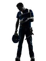one injured manual worker man with injury brace despair in silhouette on white background