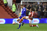 Nottingham Forest midfielder Henri Lansbury (10)  battles for possession during the EFL Sky Bet Championship match between Nottingham Forest and Cardiff City at the City Ground, Nottingham, England on 22 October 2016. Photo by Jon Hobley.