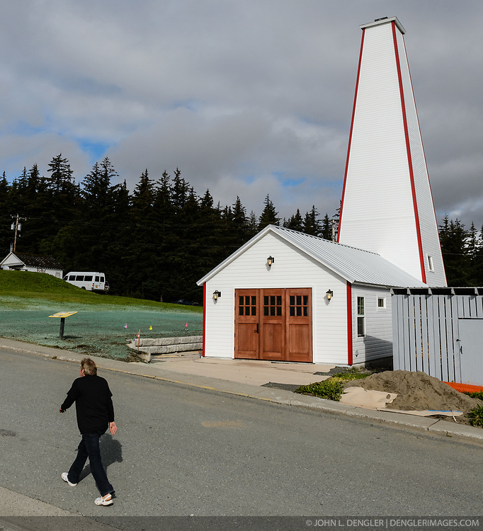 After being absent from the historic Fort Seward skyline since approximately the 1930s, the 60-foot tower of the fort&rsquo;s fire hall has been restored to its original height. The building and tower, built around 1904 in Haines, Alaska, was shortened to approximately half its height in the 1930s for unknown reasons. The restoration included rebuilding a missing 35-foot section of the 60-foot tower whose purpose was to dry fire hoses. The tower restoration was completed by building its four sections on the ground and then hoisting those sections with a crane into place on top of each other.<br /> <br /> Through the years, the historic Fort Seward area, a former U.S. Army post, has been referred to as Fort William H. Seward, Chilkoot Barracks, and Port Chilkoot. The National Historic Landmarks listing record for the fort says that &quot;Fort Seward was the last of 11 military posts established in Alaska during the territory's gold rushes between 1897 and 1904. Founded for the purpose of preserving law and order among the gold seekers, the fort also provided a U.S. military presence in Alaska during boundary disputes with Canada. The only active military post in Alaska between 1925 and 1940, the fort was closed at the end of World War II.&rdquo; <br /> <br /> The bottom portion of the fire hall is being leased as commercial space. Due to fire code restrictions there is no public access to the upper portion of the tower. <br /> <br /> The fire hall was restored over a two-year period by owners Joanne Waterman and Phyllis Sage who also own the fort&rsquo;s original guardhouse located next door to the fire hall. That building, now known as the Alaska Guardhouse, is a bed and breakfast.