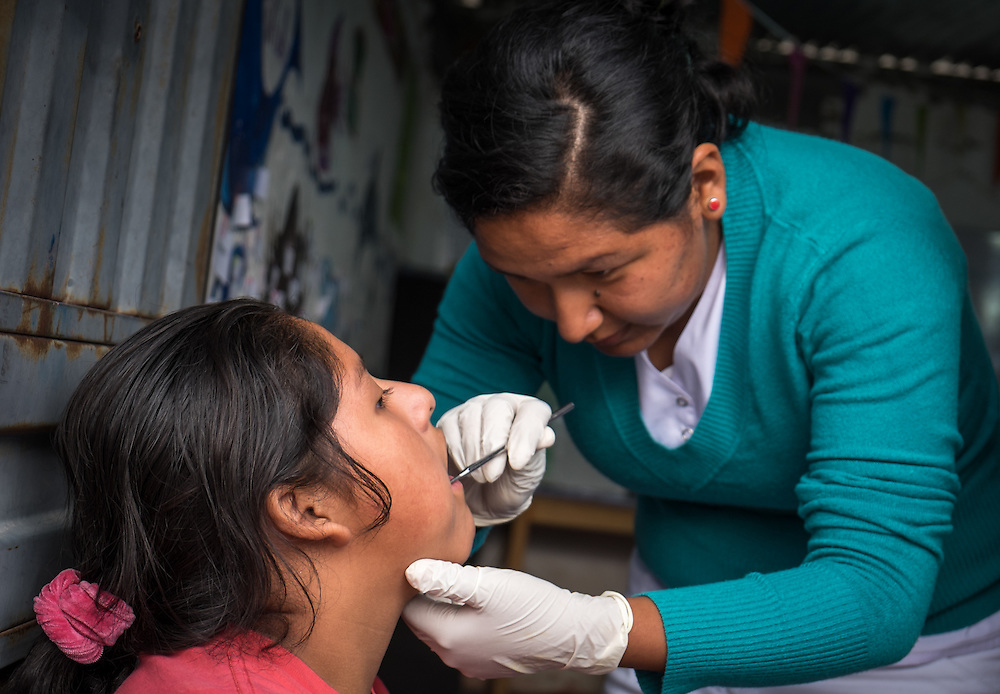 AREQUIPA, PERU - APRIL 7, 2014: Volunteer dentist working in the community of Flora Tristan for HOOP Peru. HOOP Peru is a NGO fully committed to breaking the cycle of poverty by empowering the Flora Tristan families through enhancing their education.