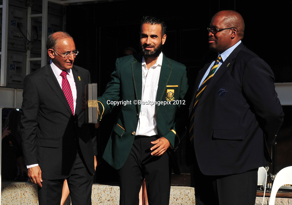 Haroon Lorgat (Cricket South Africa CEO), Imran Tahir and Chris Nenzani (President of Cricket South Africa) during the 2015 Cricket World Cup Protea squad announcement  at the V&A Waterfront, Cape Town on 7 January 2015 ©Ryan Wilkisky/BackpagePix
