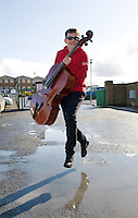 Musician Robert Murphy from Kilkenny Junior Strings on his way to play at the Annual Coole Music Orchestra Festival hosted by Coole Music  in the Community Centre, Gort, Co. Galway . The 2012 Festival was launched by Minister Ciaran Cannon, TD, and featured two concerts, each with a.very exciting musical programme. Now in its fifth year, the Festival is the only event of its kind in the West and has become a highlight on the calendars of young orchestras.throughout the country. This year's festival will feature its first international act, with Stockholm's Ungdomssinfonietta joining the line-up. Three new musical compositions will be premiered during the event, and the music will range from classical to show themes to arrangements of traditional Irish music. Photo:Andrew Downes photography