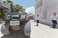 Little boys run home from school in San Pedro, Belize.  Copyright 2014 Reid McNally.