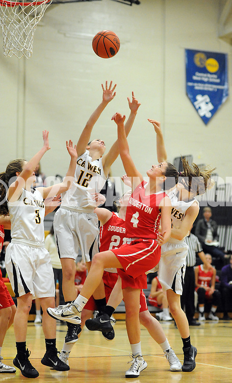 Central Bucks West's Bailey Tracy (12) and Souderton's Krista Schneider (4) try to grab a rebound in the first quarter at Central Bucks West Friday December 18, 2015 in Doylestown, Pennsylvania. (Photo by William Thomas Cain)