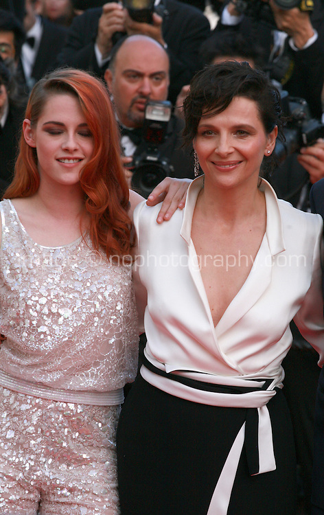 Kristen Stewart and Juliette Binoche at Sils Maria gala screening red carpet at the 67th Cannes Film Festival France. Friday 23rd May 2014 in Cannes Film Festival, France.
