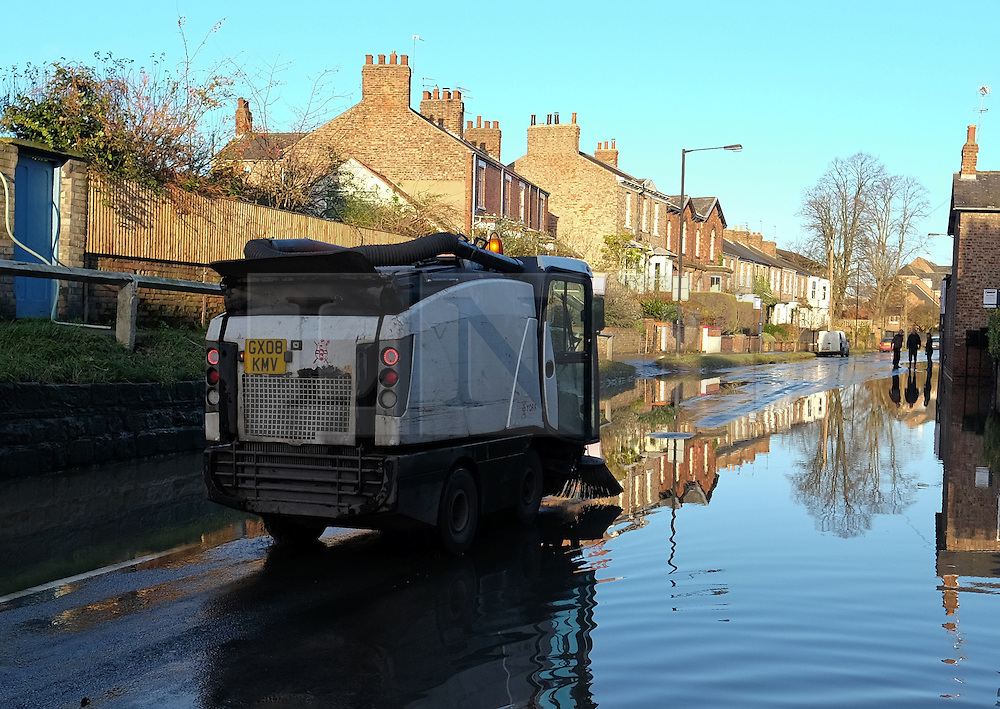 &copy; Licensed to London News Pictures. 29/12/15<br /> York, UK. <br /> <br /> Council workers begin the clean up as flood water begins to subside on Huntington Road in York. Further rainfall is expected over coming days as Storm Frank approaches the east coast of the country.<br /> <br /> Photo credit : Ian Forsyth/LNP