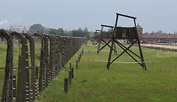 Guard towers and barbed wire fences at the Auschwitz-Birkenau Nazi concentration camps in Auschwitz, Poland on September 3, 2017. Auschwitz concentration camp was a network of German Nazi concentration camps and extermination camps built and operated by the Third Reich in Polish areas annexed by Nazi Germany during WWII. It consisted of Auschwitz I (the original camp), Auschwitz II–Birkenau (a combination concentration/extermination camp), Auschwitz II–Monowitz (a labor camp to staff an IG Farben factory), and 45 satellite camps. In September 1941, Auschwitz II–Birkenau went on to become a major site of the Nazi Final Solution to the Jewish Question. From early 1942 until late 1944, transport trains delivered Jews to the camp's gas chambers from all over German-occupied Europe, where they were killed en masse with the pesticide Zyklon B. An estimated 1.3 million people were sent to the camp, of whom at least 1.1 million died. Around 90 percent of those killed were Jewish; approximately 1 in 6 Jews killed in the Holocaust died at the camp. Others deported to Auschwitz included 150,000 Poles, 23,000 Romani and Sinti, 15,000 Soviet prisoners of war, 400 Jehovah's Witnesses, and tens of thousands of others of diverse nationalities, including an unknown number of homosexuals. Many of those not killed in the gas chambers died of starvation, forced labor, infectious diseases, individual executions, and medical experiments. In 1947, Poland founded a museum on the site of Auschwitz I and II, and in 1979, it was named a UNESCO World Heritage Site. Photo by Somer/ABACAPRESS.COM