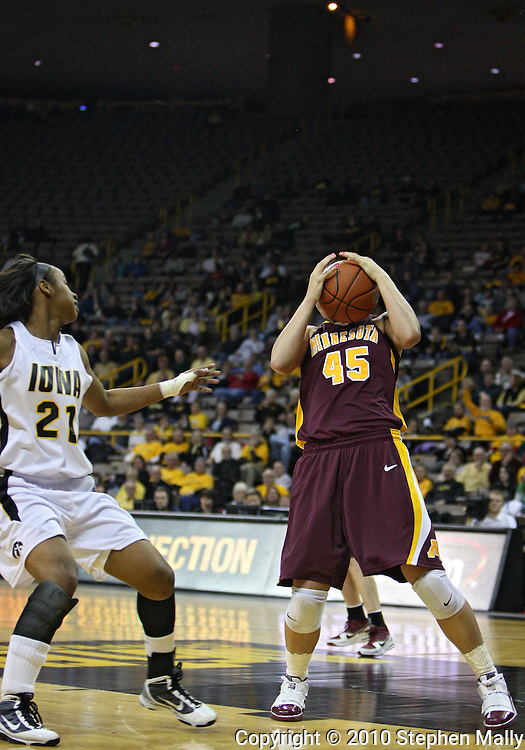 February 18, 2010: Minnesota forward Jackie Voigt (45) grabs a rebound during the first half of the NCAA women's basketball game at Carver-Hawkeye Arena in Iowa City, Iowa on February 18, 2010. Iowa defeated Minnesota 75-54.