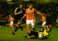 MATTHEW POVER PICTURE                                                +447971 184305<br /> <br /> 11/12/07 .... Blackpool v Cardiff<br /> Blackpool's Kaspars Gorkss holds off Cardiff's Roger Johnson as he closes on Cardiff Blackpool keeper Paul Rachubka.
