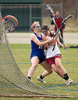 Londonderry's Julia Wasserman stands her ground as Concord's Adelaide Symmes tries to go to the goal during NHIAA Division I Lacrosse Tuesday.  (Karen Bobotas/for the Concord Monitor)