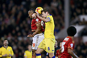 Nottingham Forest forward, on loan from Brighton & Hove albion, Chris O'Grady  and Leeds United defender Liam Cooper  during the Sky Bet Championship match between Nottingham Forest and Leeds United at the City Ground, Nottingham, England on 27 December 2015. Photo by Simon Davies.