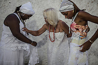 RIO DE JANEIRO, BRAZIL - JANUARY 24: Practitioners prepare their outfits for a candomble ceremony, in Rio de Janeiro, Brazil, on Saturday, Jan. 23, 2015. Brazil's Afro-Brazilian religions which in recent years have come under increasing threats and prejudice, particularly from the growing number of evangelical churches. Candombl&eacute; originated in Salvador, Bahia at the beginning of the 19th century when enslaved Africans brought their beliefs with them. Umbanda and candombl&eacute; are Afro-Brazilian religions practiced in mostly Brazil. <br /> (Lianne Milton for the Washington Post)