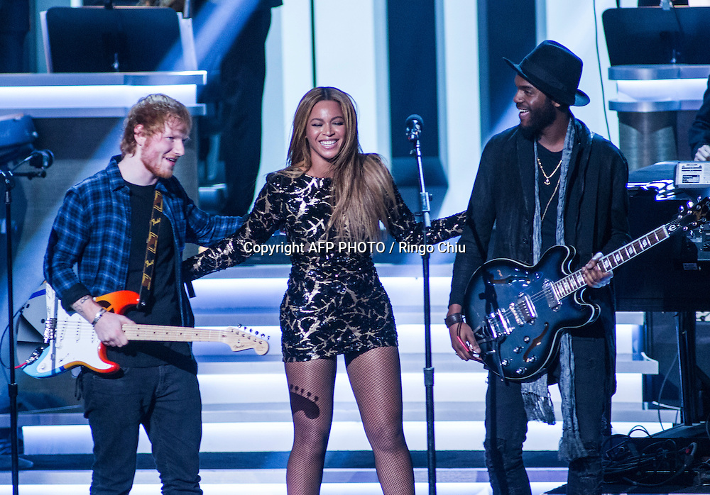 Ed Sheeran, left, Beyonce, center, and Gary Clark Jr. join together onstage after their performance during a concert, Stevie Wonder: Songs In The Key Of Life - An All-Star GRAMMY Salute, at Nokia Theatre L.A. Live on February 10, 2015 in Los Angeles, California. AFP PHOTO / Ringo Chiu