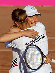 Katarina Srebotnik (R) and Polona Hercog  of Slovenia celebrate after winning the doubles  against Rebecca Marino and Sharon Fichman of Canada at the second day of the tennis Fed Cup match between Slovenia and Canada at Bonifika, on April 17, 2011 in Koper, Slovenia. Slovenia won 3-2 and stays in World Group II.  (Photo by Vid Ponikvar / Sportida)