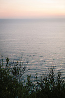 ACCIAROLI, ITALY - 14 SEPTEMBER 2018: A view of the sea at dusk from Acciaroli, a small fishing village in the municipality of Pollica, Italy, on September 14th 2018.<br /> <br /> To understand how people can live longer throughout the world, researchers at University of California, San Diego School of Medicine have teamed up with colleagues at University of Rome La Sapienza to study a group of 300 citizens, all over 100 years old, living in Acciaroli (Pollica), a remote Italian village nestled between the ocean and mountains in Cilento, southern Italy.<br /> <br /> About 1-in-60 of the area's inhabitants are older than 90, according to the researchers. Such a concentration rivals that of other so-called blue zones, like Sardinia and Okinawa, which have unusually large percentages of very old people. In the 2010 census, about 1-in-163 Americans were 90 or older.