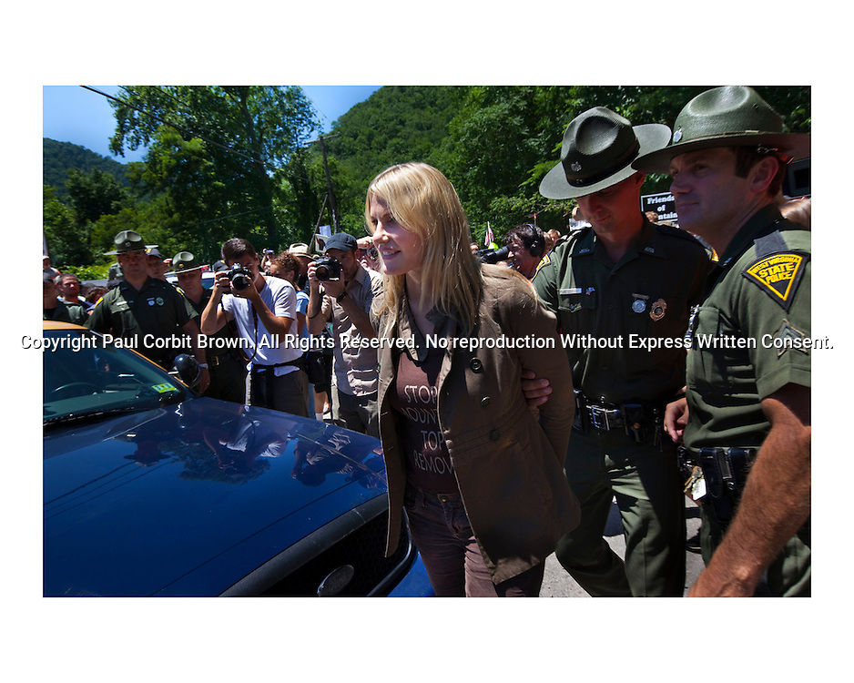 Actress Daryl Hannah is arrested June 23, 2009 in an anti MTR rally near Whitesville, WV. Celebrity involvement in civil disobedience actions attracts much needed attention for an issue of global importance, of which alarmingly little is known. Images from West Virginia and the devastating practice of Mountaintop Removal Coal Mining. Covering the aspects of destruction of the land, violation of humanity and the irreversible contamination of the water of Appalachia. Images from West Virginia and the devastating practice of Mountaintop Removal Coal Mining. Covering the aspects of destruction of the land, violation of humanity and the irreversible contamination of the water of Appalachia. Images from West Virginia and the devastating practice of Mountaintop Removal Coal Mining. Covering the aspects of destruction of the land, violation of humanity and the irreversible contamination of the water of Appalachia. Images from West Virginia and the devastating practice of Mountaintop Removal Coal Mining. Covering the aspects of destruction of the land, violation of humanity and the irreversible contamination of the water of Appalachia.