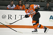 RIT Senior Captain Lindsay Grigg takes a shot during an exhibition game at RIT's Gene Polisseni Center on Monday, September 29, 2014.