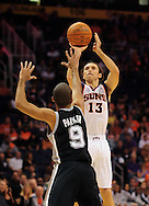 Nov. 3 2010; Phoenix, AZ, USA; Phoenix Suns guard Steve Nash (13) puts up a basket during the first quarter against San Antonio Spurs guard Tony Parker (9) at the US Airways Center. Mandatory Credit: Jennifer Stewart-US PRESSWIRE.